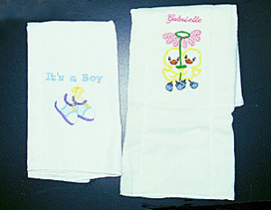 Two more designs for burp cloths with a ribbon trim. The thread colors can be done for a boy or girl or whatever colors you choose. $8.00 Item # AWEMB 023